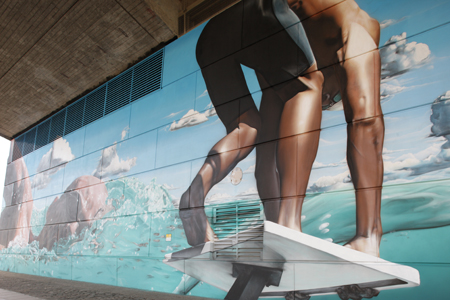 Commonwealth Games mural under the Kingston Bridge by artist Sam Bates